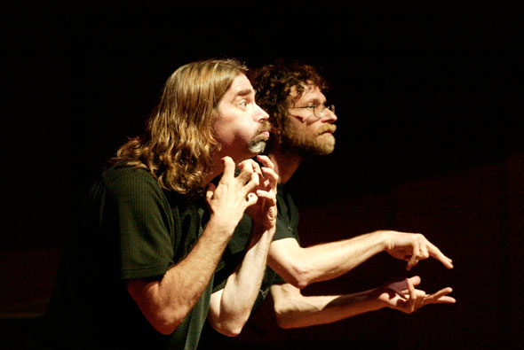 Deaf poet Peter Cook and hearing co-author Kenny Lerner, performing.